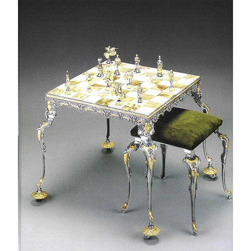 Medieval Battle 13th Century chess set with table and optional chairs. Handmade in lost wax cast bronze with 24kt gold and silver finish.