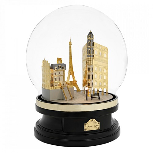 S.T. Dupont From Paris With Love Collector contains both a Ligne 2 Lighter and a Line D fountain pen in an exclusive glass globe set on a black wood stand, featuring a Parisian skyline decor.