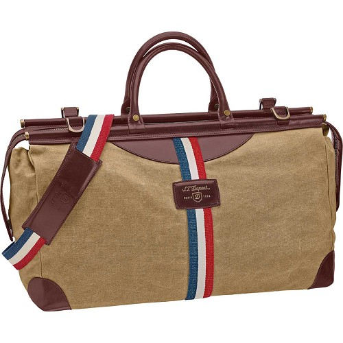 ST Dupont Iconic Bogie Duffle Bag in Beige/Cognac includes matching shoulder strap.
